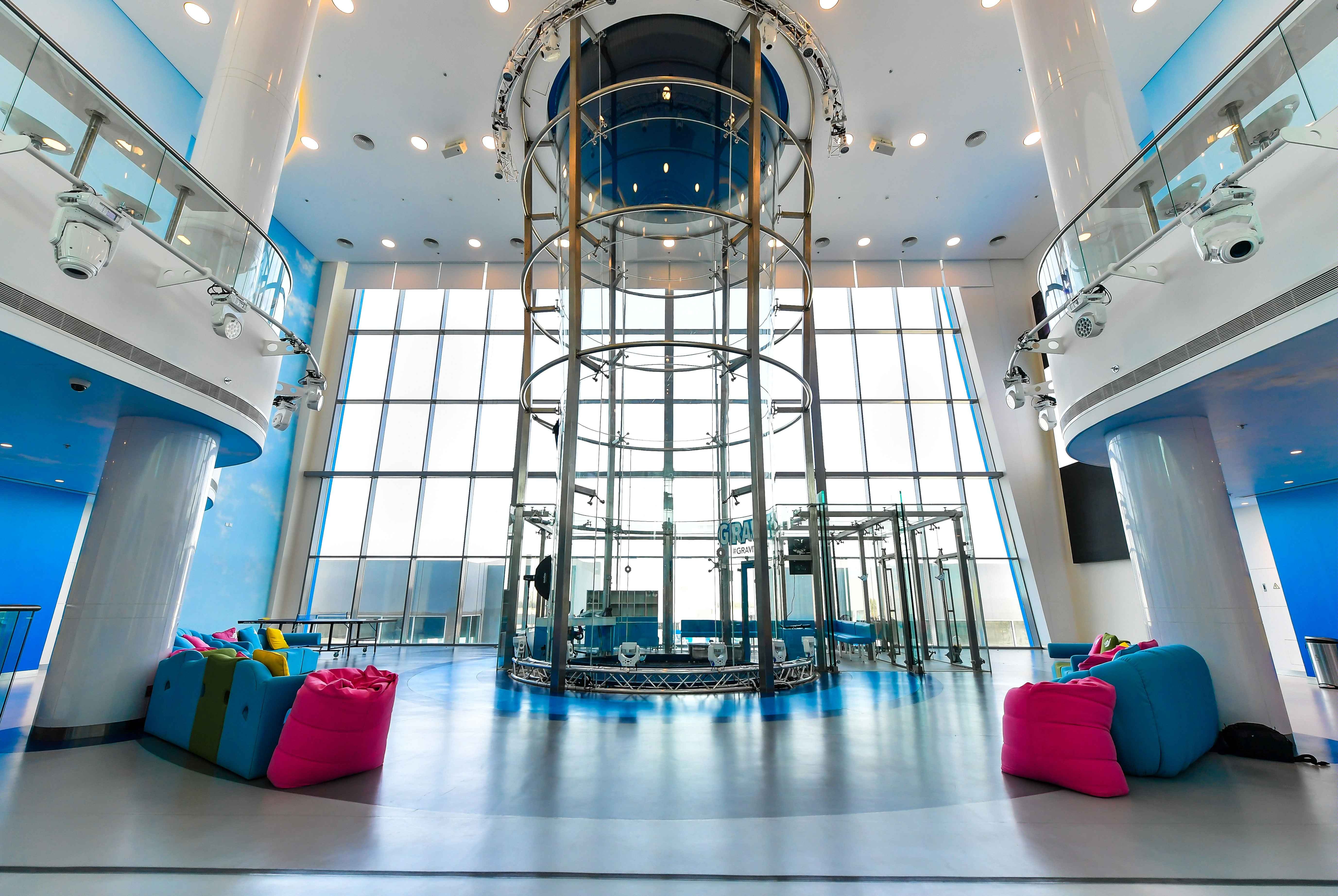 Wind tunnels are engineering marvels – vertical columns of air, creating 'indoor skydiving'! Image taken at Gravity Bahrain, one of the world's tallest glass tunnels
