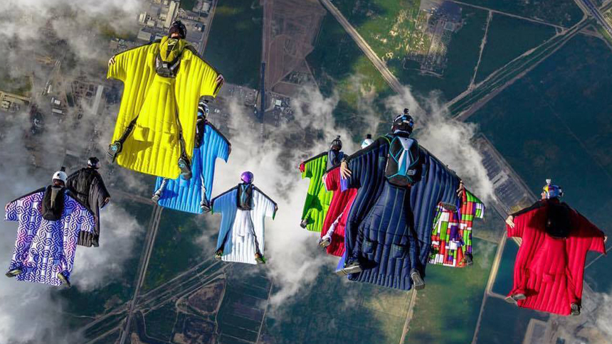 wingsuits in tight formation - squirrel  - next level